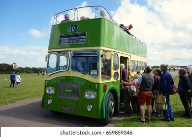 SOUTHSEA, ENGLAND - JUNE 11. Open top buses like this classic example are a popular means of tourist transport in seaside resorts as well as cities. June 11, 2017 in Southsea, England.