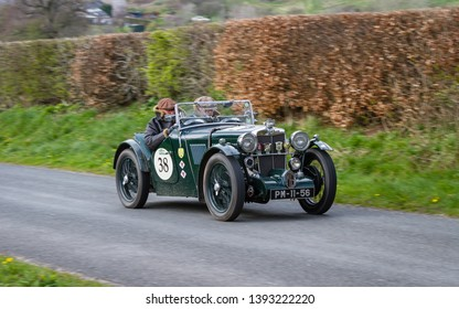 SOUTHWAITE, ENGLAND - APRIL 5:  A 1933 MG J2 Supercharged climbs Southwaite Hill in Cumbria, England on April 5, 2019.  The car is taking part in the 11th Flying Scotsman Rally, a free public-event.