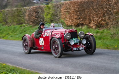 SOUTHWAITE, ENGLAND - APRIL 5:  A 1934 Aston Martin Ulster climbs Southwaite Hill in Cumbria, England on April 5, 2019.  The car is taking part in the 11th Flying Scotsman Rally, a free public-event.