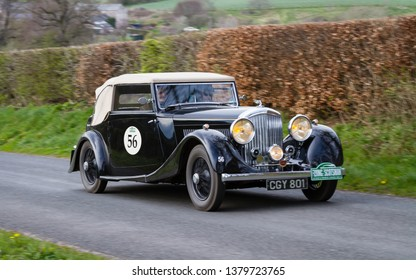 SOUTHWAITE, ENGLAND - APRIL 5:  A 1935 Bentley 3.5 climbs Southwaite Hill in Cumbria, England on April 5, 2019.  The car is taking part in the 11th Flying Scotsman Rally, a free public-event.