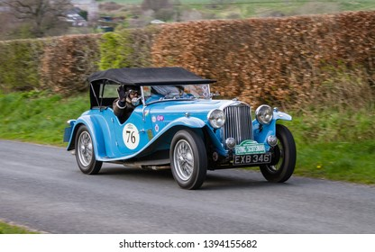 SOUTHWAITE, ENGLAND - APRIL 5:  A 1936 AC March 16/18 Speciale climbs Southwaite Hill, Cumbria, England on April 5, 2019. The car is taking part in the 11th Flying Scotsman Rally, a free public-event.