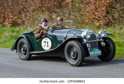 SOUTHWAITE, ENGLAND - APRIL 5:  A 1936 Morgan 4/4 Roadster climbs Southwaite Hill in Cumbria, England on April 5, 2019.  The car is taking part in the 11th Flying Scotsman Rally, a free public-event.
