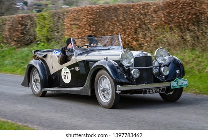 SOUTHWAITE, ENGLAND - APRIL 5:  A 1936 Alvis Speed 20 climbs Southwaite Hill in Cumbria, England on April 5, 2019.  The car is taking part in the 11th Flying Scotsman Rally, a free public-event.