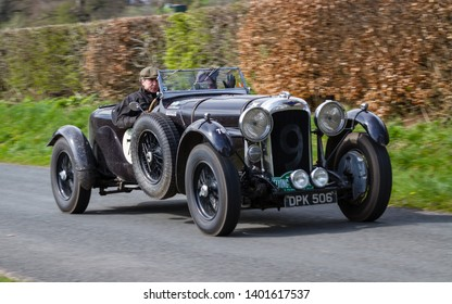 SOUTHWAITE, ENGLAND - APRIL 5:  A 1936 Lagonda LG45 climbs Southwaite Hill in Cumbria, England on April 5, 2019.  The car is taking part in the 11th Flying Scotsman Rally, a free public-event.