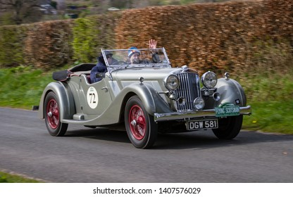 SOUTHWAITE, ENGLAND - APRIL 5:  A 1936 Talbot BG110 climbs Southwaite Hill in Cumbria, England on April 5, 2019.  The car is taking part in the 11th Flying Scotsman Rally, a free public-event.