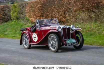 SOUTHWAITE, ENGLAND - APRIL 5:  A 1936 MG PB Tourer climbs Southwaite Hill in Cumbria on April 5, 2019.  The car is taking part in the 11th Flying Scotsman Rally, a free public-event.