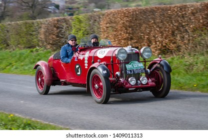SOUTHWAITE, ENGLAND - APRIL 5:  A 1936 Lagonda Le Mans climbs Southwaite Hill in Cumbria on April 5, 2019.  The car is taking part in the 11th Flying Scotsman Rally, a free public-event.
