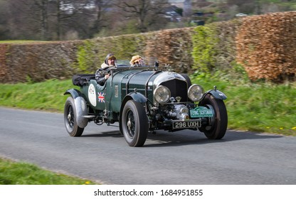 SOUTHWAITE, ENGLAND - APRIL 5:  A 1936 Bentley Tourer climbs Southwaite Hill in Cumbria on April 5, 2019.  The car is taking part in the 11th Flying Scotsman Rally, a free public-event.