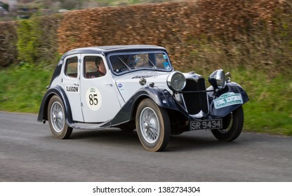 SOUTHWAITE, ENGLAND - APRIL 5:  A 1937 Riley 15/6 climbs Southwaite Hill in Cumbria, England on April 5, 2019.  The car is taking part in the 11th Flying Scotsman Rally, a free public-event.