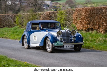 SOUTHWAITE, ENGLAND - APRIL 5:  A 1937 Alvis 4.3L VDP Tourer climbs Southwaite Hill in Cumbria, England on April 5, 2019. The car is taking part in the 11th Flying Scotsman Rally, a free public-event.