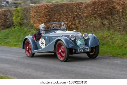 SOUTHWAITE, ENGLAND - APRIL 5:  A 1937 Riley Sprite climbs Southwaite Hill in Cumbria, England on April 5, 2019.  The car is taking part in the 11th Flying Scotsman Rally, a free public-event.