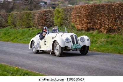 SOUTHWAITE, ENGLAND - APRIL 5:  A 1937 Frazer Nash BMW 328 climbs Southwaite Hill in Cumbria, England on April 5, 2019.  The car is taking part in the 11th Flying Scotsman Rally, a free public-event.