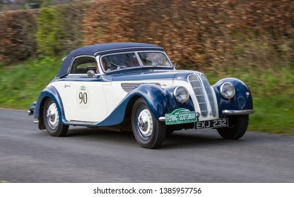 SOUTHWAITE, ENGLAND - APRIL 5:  A 1938 Frazer Nash BMW 327/8 climbs Southwaite Hill in Cumbria, England on April 5, 2019. The car is taking part in the 11th Flying Scotsman Rally, a free public-event.