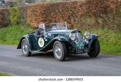 SOUTHWAITE, ENGLAND - APRIL 5:  A 1938 Aston Martin 15/98 climbs Southwaite Hill in Cumbria, England on April 5, 2019.  The car is taking part in the 11th Flying Scotsman Rally, a free public-event.