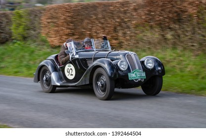 SOUTHWAITE, ENGLAND - APRIL 5:  A 1938 Frazer Nash BMW 328 climbs Southwaite Hill in Cumbria, England on April 5, 2019.  The car is taking part in the 11th Flying Scotsman Rally, a free public-event.