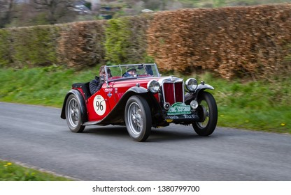 SOUTHWAITE, ENGLAND - APRIL 5:  A 1939 MG TB Supercharged climbs Southwaite Hill in Cumbria, England on April 5, 2019.  The car is taking part in the 11th Flying Scotsman Rally, a free public-event.