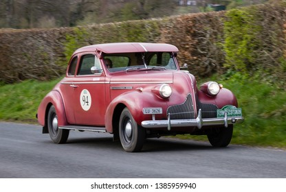 SOUTHWAITE, ENGLAND - APRIL 5:  A 1939 Buick Century climbs Southwaite Hill in Cumbria, England on April 5, 2019.  The car is taking part in the 11th Flying Scotsman Rally, a free public-event.