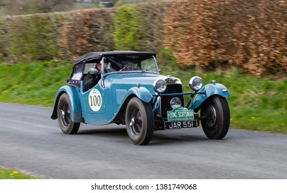 SOUTHWAITE, ENGLAND - APRIL 5:  A 1947 HRG 1500 climbs Southwaite Hill in Cumbria, England on April 5, 2019.  The car is taking part in the 11th Flying Scotsman Rally, a free public-event.