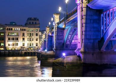 Southwark Bridge, London, illuminated at night
