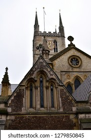 Southwark Cathedral. Tower with golden clock and east end. South Bank, London, United Kingdom.