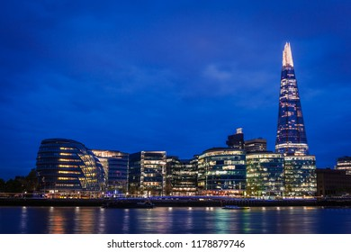 The Southwark skyline over the river Thames at night, London, United Kingdom