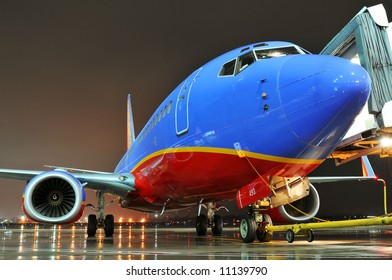 Southwest Airlines airplane at the departing gate at night