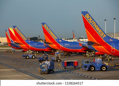 Southwest Airlines Boeing 737 airplanes prepare for takeoff and arrive at Chicago Midway International Airport, August 11, 2018.