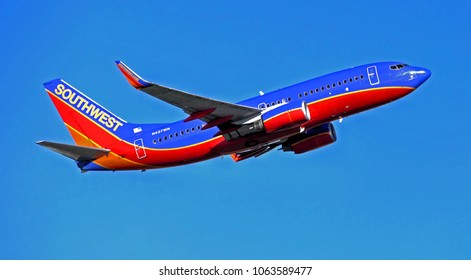 Southwest Airlines jet plane departure climbs skyward after taking off from the runway - Logan Airport Boston, Massachusetts USA - August 30, 2014