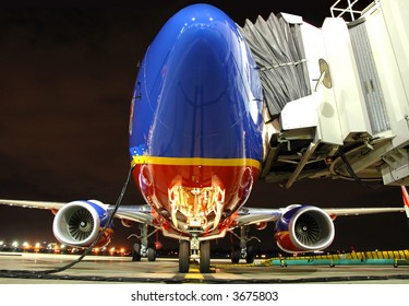 Southwest Airlines plane at the gate at night