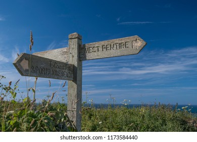 Southwest Coast Path sign near West Pentire, Cornwall, England.