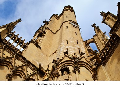 Southwest corner of the Metz Cathedral. with entrance, cock tower, flying buttress,  and gothic arches. Cathedral of Saint Stephen of Metz (French: Cathédrale Saint Étienne de Metz)