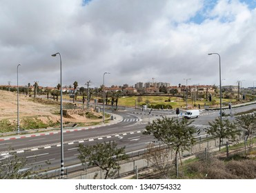 the southwest entrance to the development town of arad in the negev on a stormy winter day showing a major highway intersection