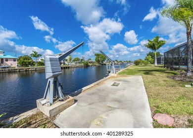 Southwest Florida homes on a canal.  View of canal homes and boat lift on the canal.