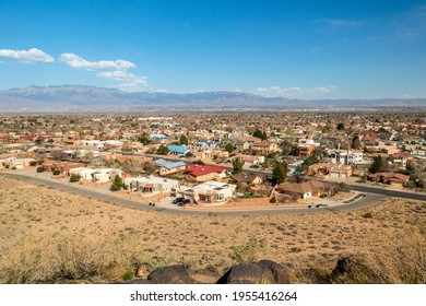 Southwest living. Albuquerque Metro Area Residential Panorama with the view of Sandia Mountains on the distance. Petroglyph National Monument, New Mexico