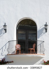 southwest style window and balcony with two chairs