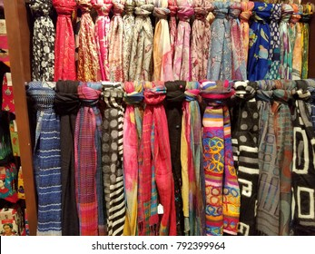 Southwestern, Bright, Multi-Colored High Fashion Scarves, Lined Up Vertically Close on Double Racks, Easily Showing Pattern Varieties of Spanish American/American Indian/ Southwestern Styles