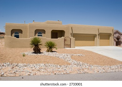southwestern style house with rock garden landscaping