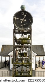 Southwold, Norfolk. England - November 4, 2018 : The water clock  is an eccentric working art installation made from salvaged metal on the pier.