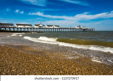 Southwold pier and beach in Suffolk coast on sunny day