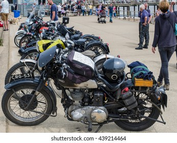 SOUTHWOLD, SUFFOLK/UK - JUNE 11 : Vintage Motorcycles on Display in Southwold Suffolk on June 11, 2016. Unidenntified people