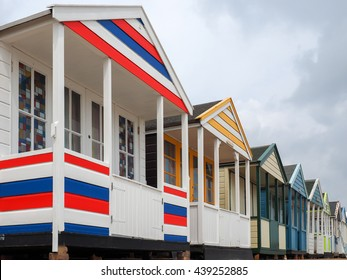 SOUTHWOLD, SUFFOLK/UK - JUNE 12 : A Row of Brightly Coloured Beach Huts at Southwold in Suffolk on June 12, 2016.
