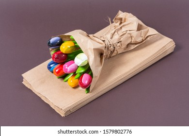 souvenir bouquet of wooden tulips wrapped in craft paper on a brown background