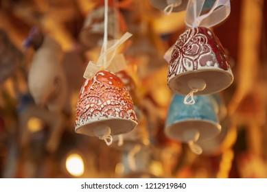 Souvenir christmas ceramic bells at the market, seasonal holiday background