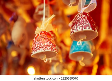 Souvenir christmas ceramic bells at the market, seasonal holiday background