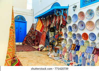 Souvenir earthenware and carpets in tunisian market, Sidi Bou Said, Tunisia.