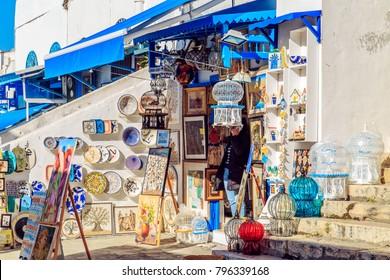 Souvenir earthenware in tunisian market. SIDI BOU SAID, TUNISIA - NOVEMBER 22, 2017.