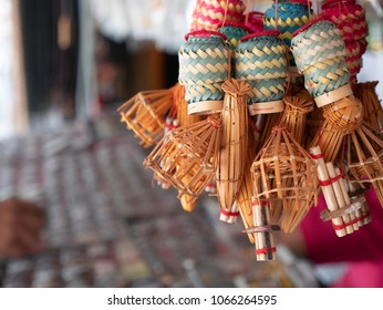 souvenir gift present lagniappe from the  northeast of Thailand  include the mini wicker boxes for Sticky rice  , mini Lao reed mouthorgan and mini fish trap