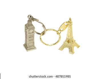 souvenir keychains: Big Ben (London, Great Britain) and Eiffel Tower (Paris, France) connected together with chains isolated over white, symbolizing brexit, economy, connectivity and association