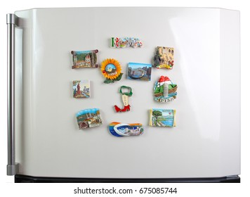 Souvenir magnets of the cities of Italy on the door of the refrigerator