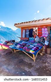 Souvenir market on street of Ollantaytambo,Peru,South America. Colorful blanket, cap, scarf, cloth, ponchos from  wool of alpaca, llama